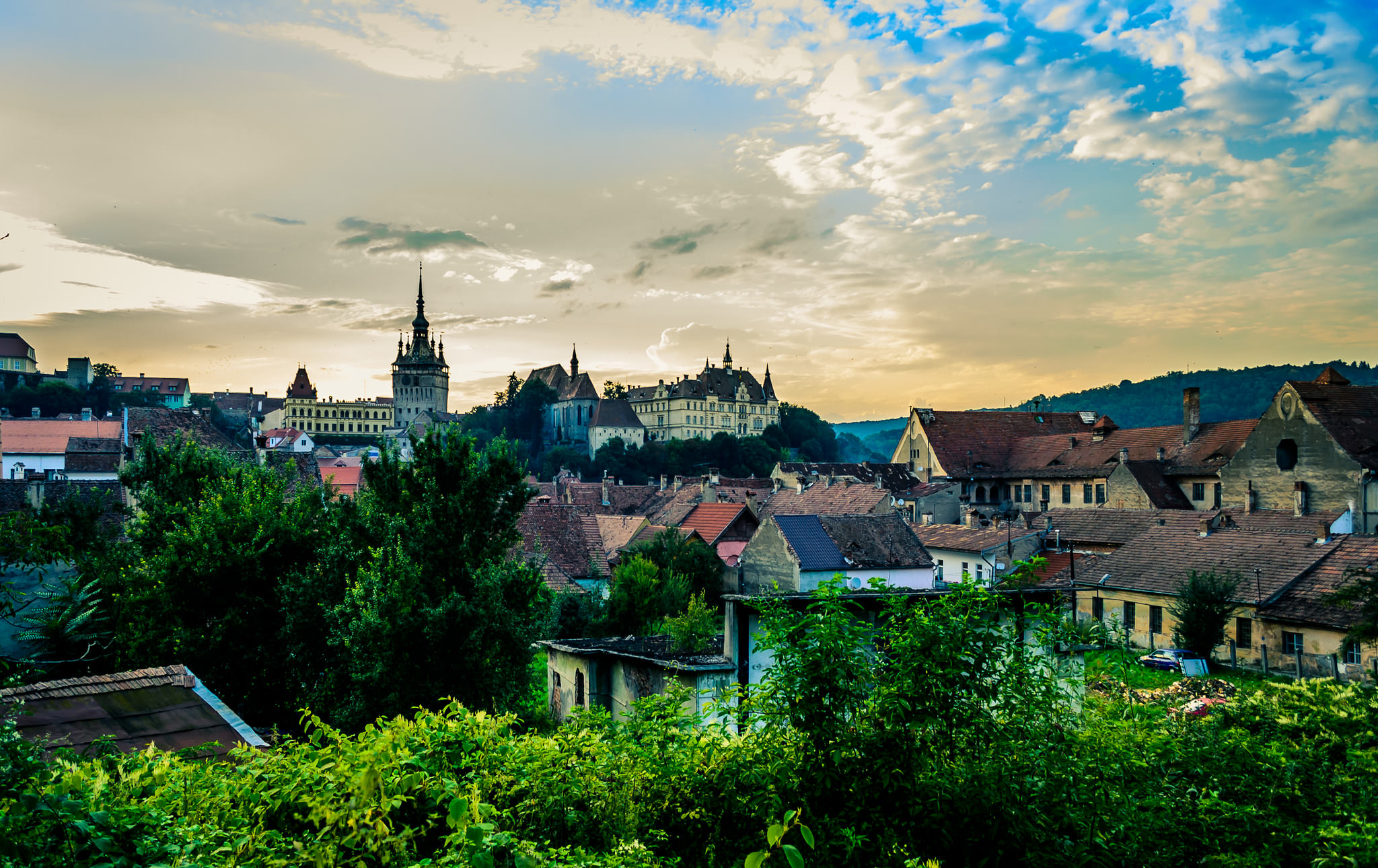 Sunset over the medieval city of Sighișoara, Romania (copyright:  creative commons )