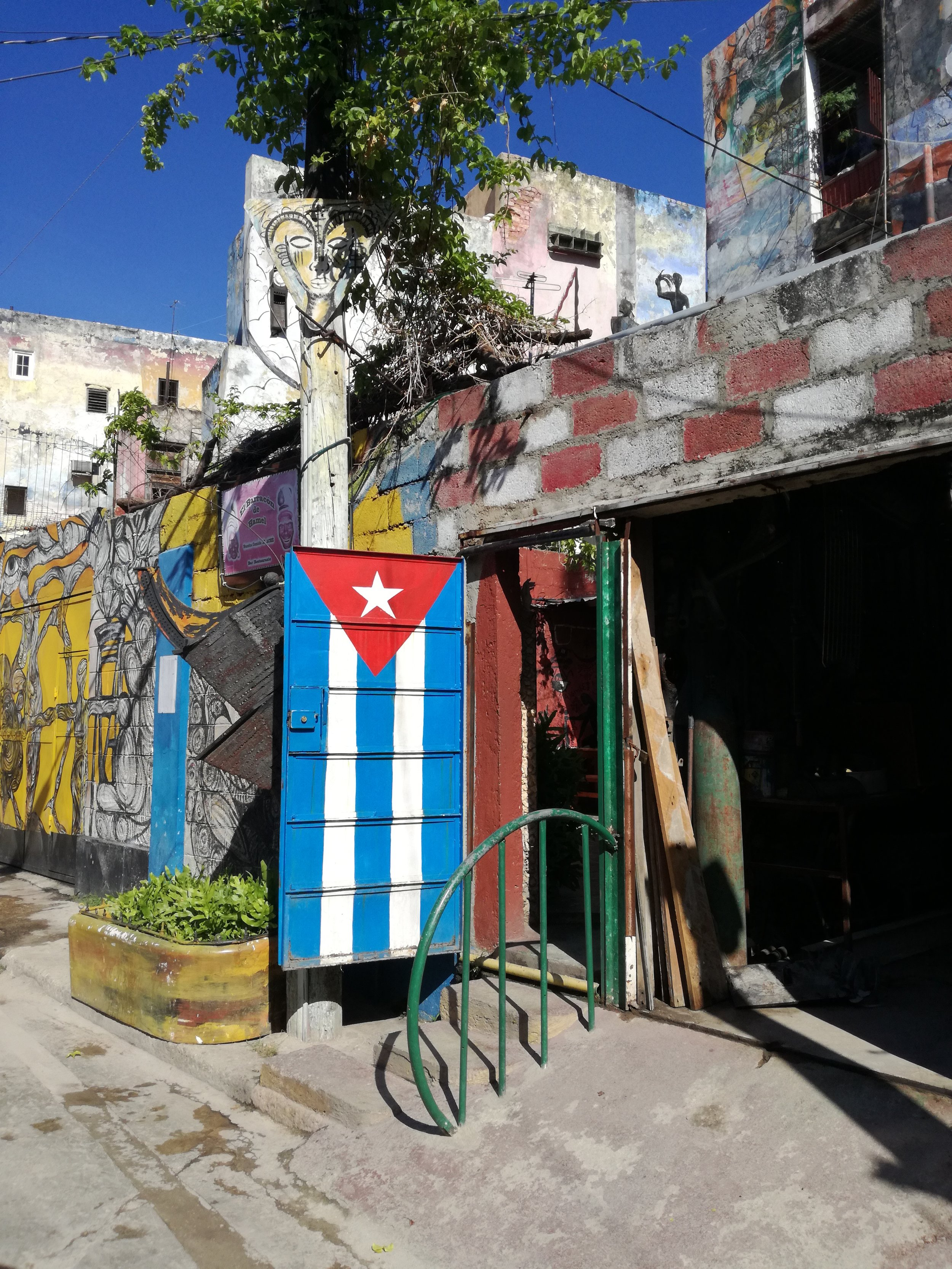 Cuba is full of such amazing art. On most building walls, you will find creative expressions, often with patriotic messages. This was at Callejon de Hamel.