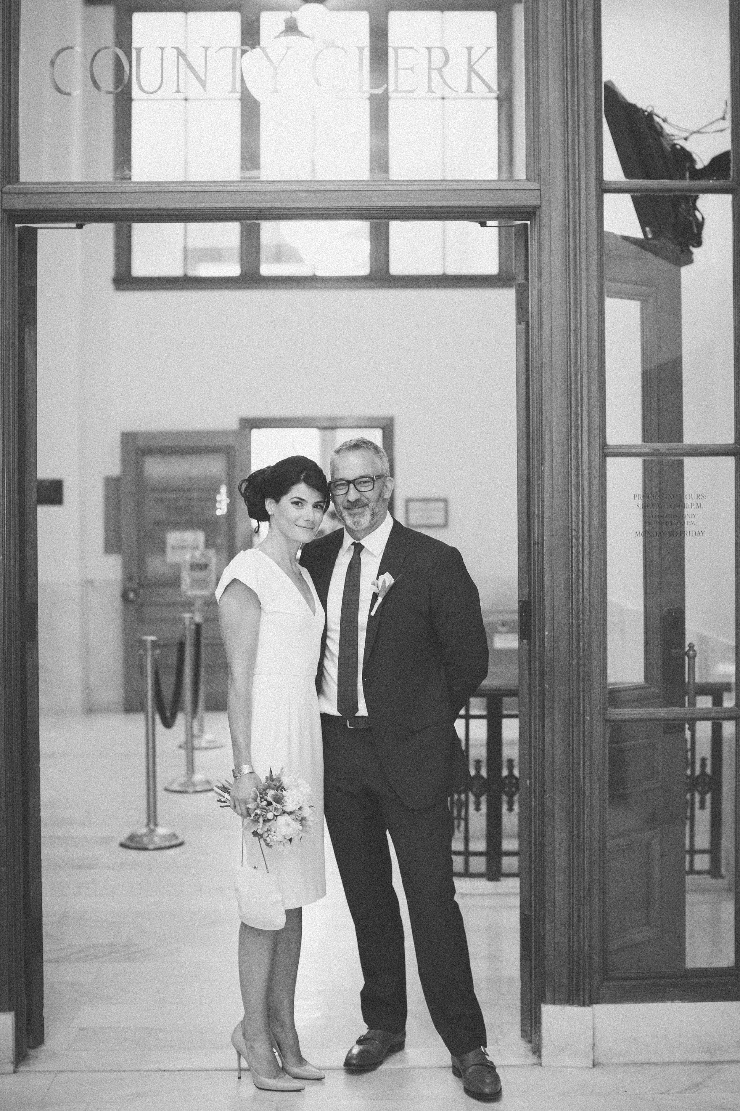 bride and groom at county clerk's office San Francisco City Hall