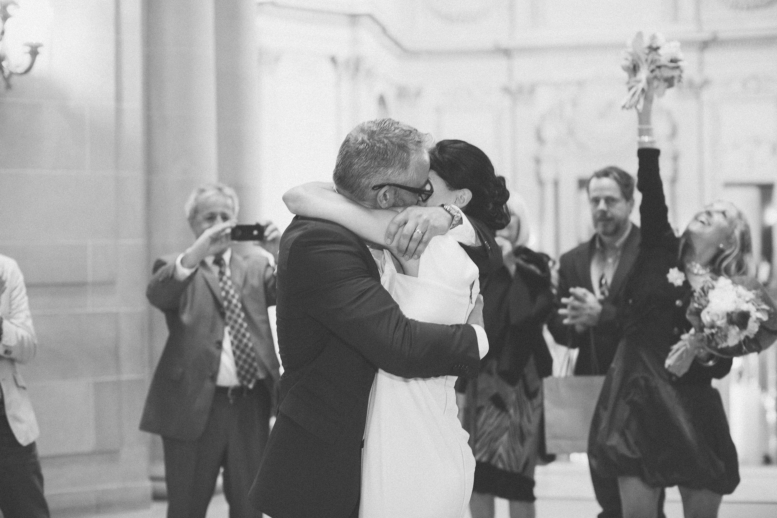 san francisco city hall wedding ceremony kiss under rotunda