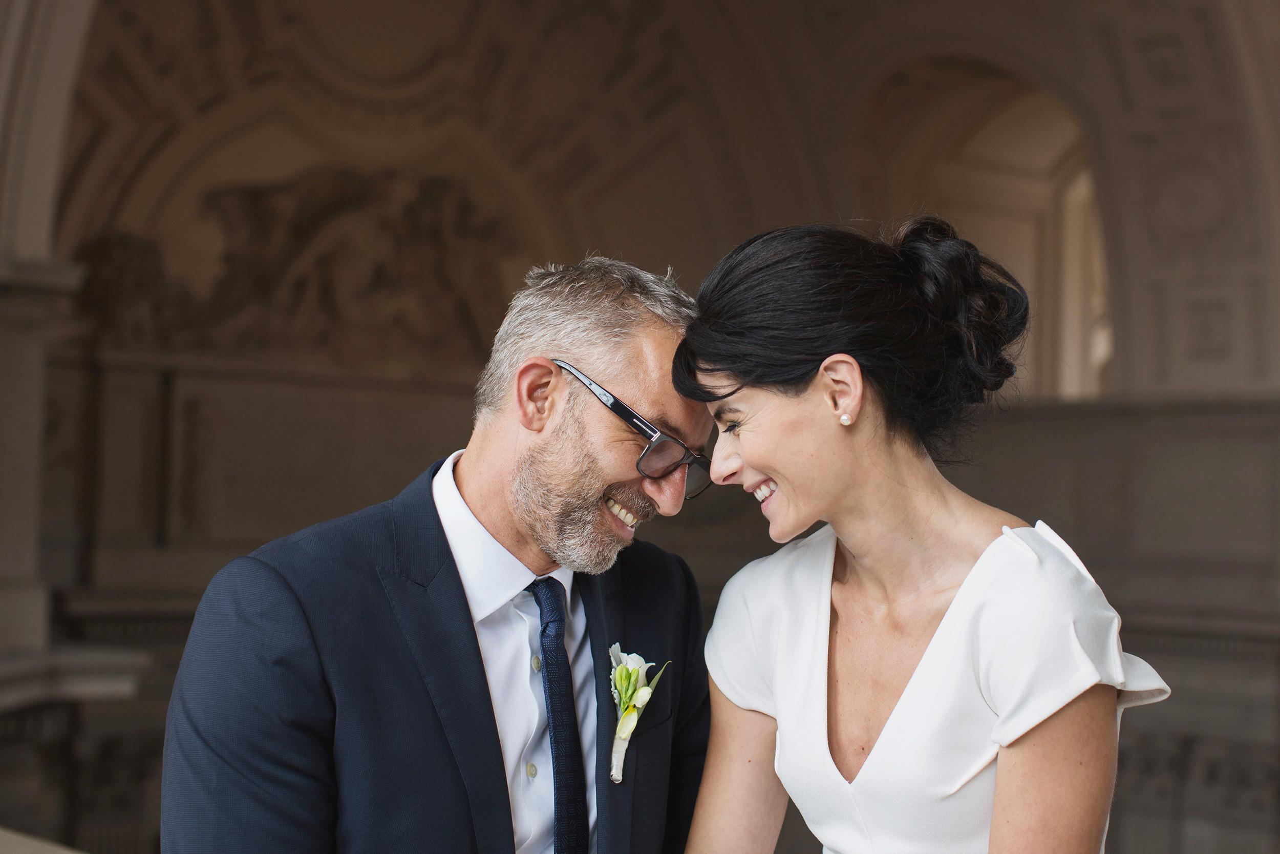 bride and groom on fourth floor San Francisco City Hall