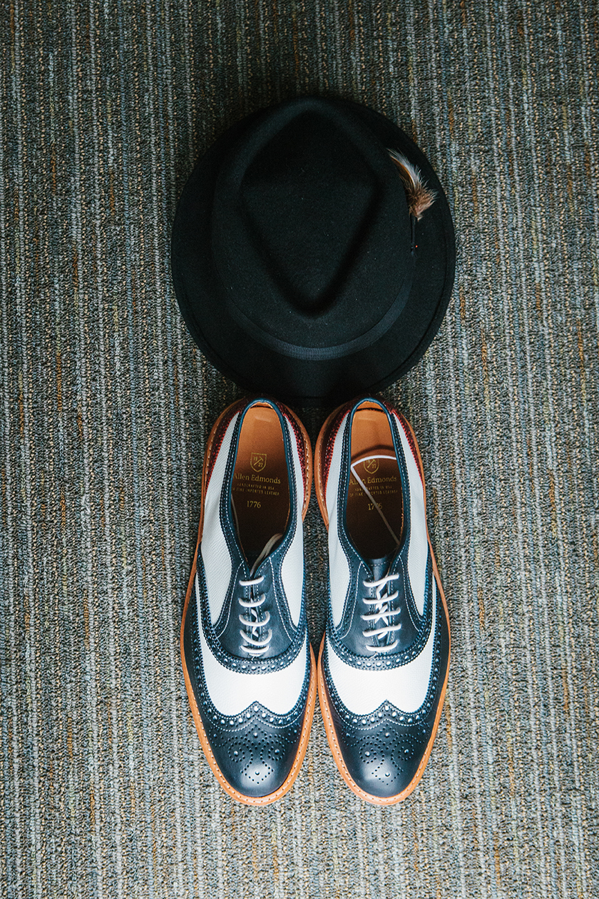 Groom's two-tone shoes from Allen Edmonds, and fedora hat