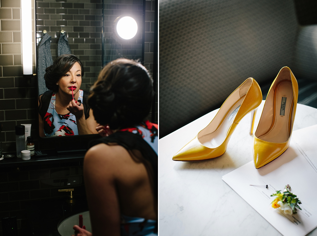 The bride applies her lipstick at the Proper Hotel in San Francisco. The bride's yellow Prada shoes and the groom's boutonniere from Ampersand.