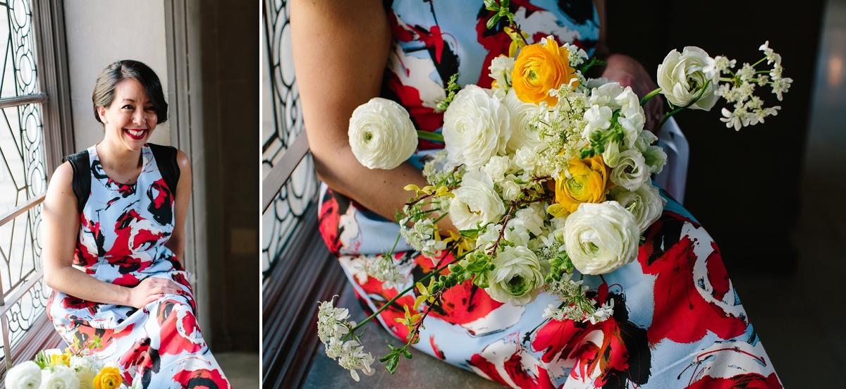 The bride sitting in the window with her yellow and white bouquet at San Francisco City Hall.