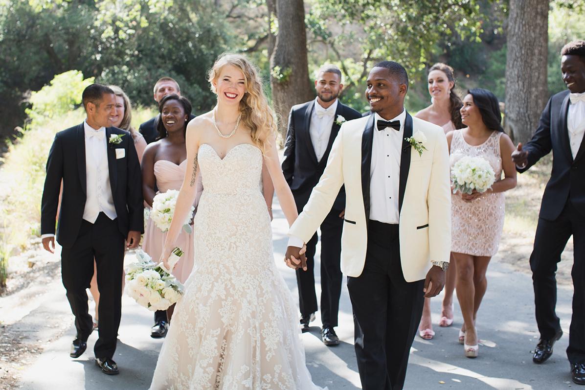 Bride and groom walk with their wedding party in Walnut Creek, California.