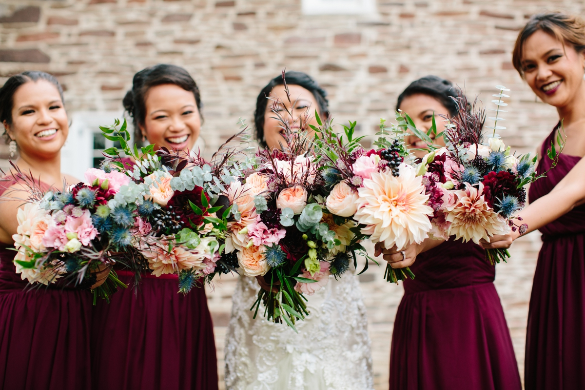 The bridesmaids and bride show off their fall bouquets at Washington Crossing Park.