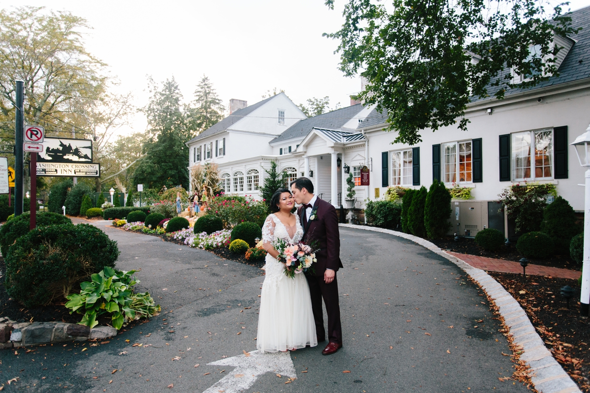 The bride and groom in front of their wedding venue the Washington Crossing Inn.