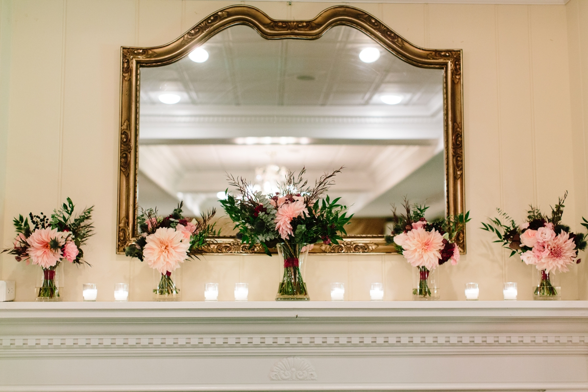 All the bridal bouquets on the mantle during the wedding reception at Washington Crossing Inn.