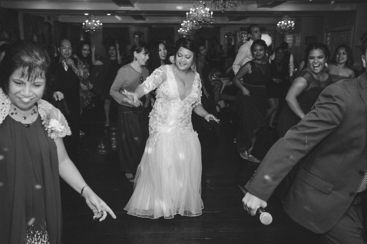 The bride takes to the dance floor with guests during the wedding reception at Washington Crossing Inn.