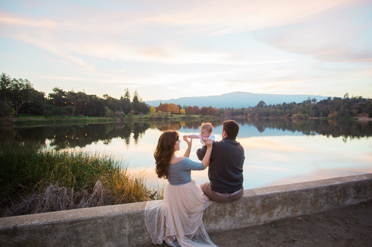 Sunset over Vasona Lake in Los Gatos, while a young family sits on the dam.
