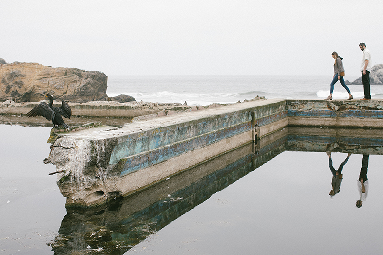 Walking along the borders of the Sutro Baths ruins in San Francisco.