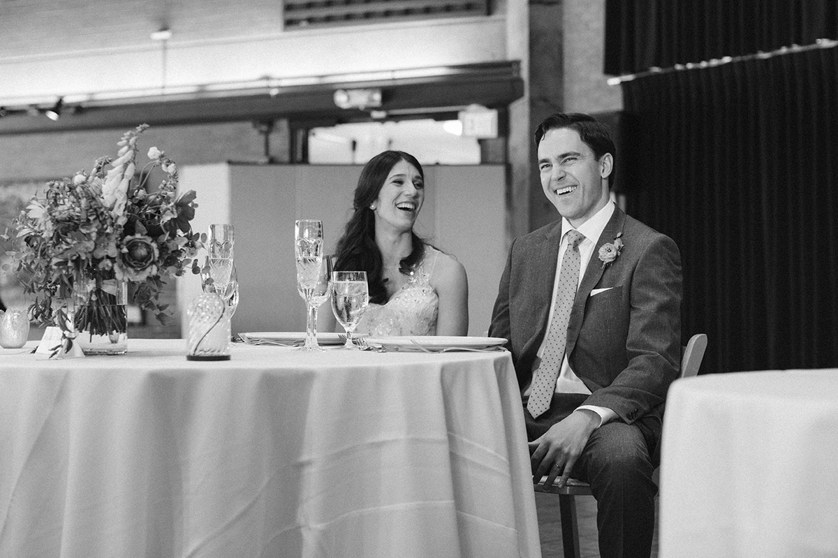Groom_laughing_stanfordfacultyclub_weddingreception_SonyaYruel.jpg
