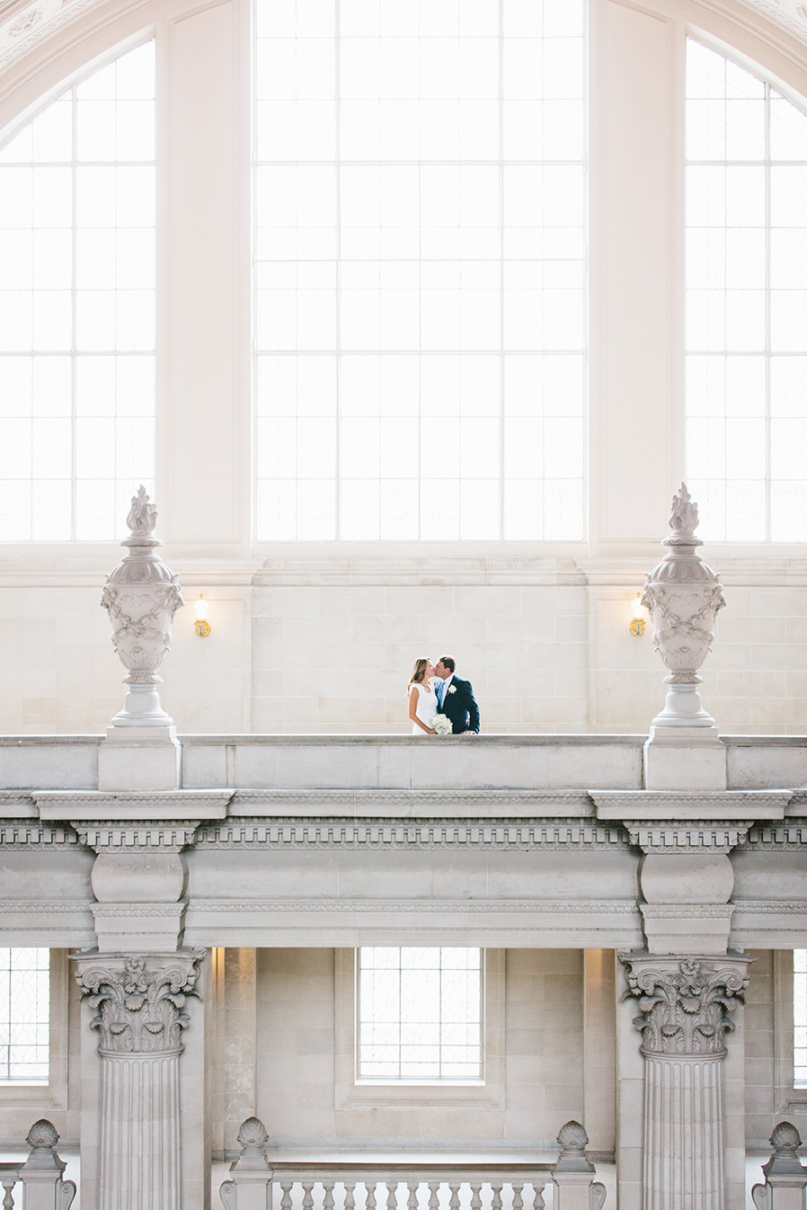 FourthFloor_SanFrancisco_CityHall_Bride_Groom_kiss.jpg