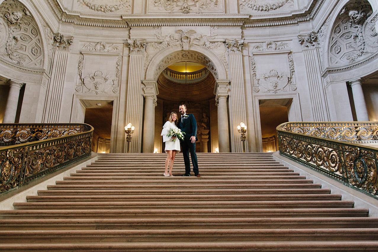 Bride_and_groom_on_Grand_Staircase_SanFrancisco_City_Hall_SonyaYruel.jpg