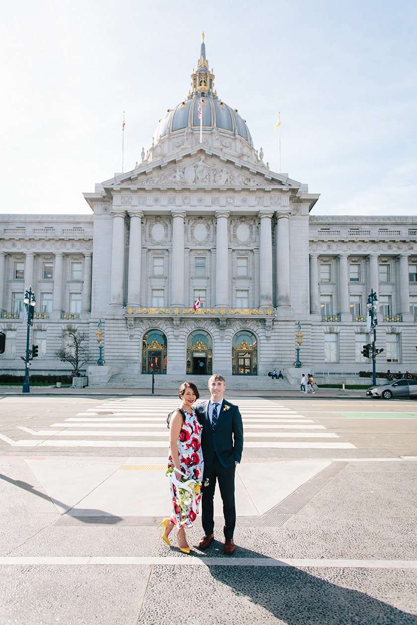 Newly weds at Civic Center Plaza, across from the front of San Francisco City Hall.