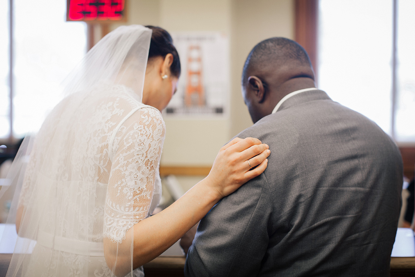 A bride and groom fill out paper work inside the County Clerk's Office at San Francisco's City Hall.
