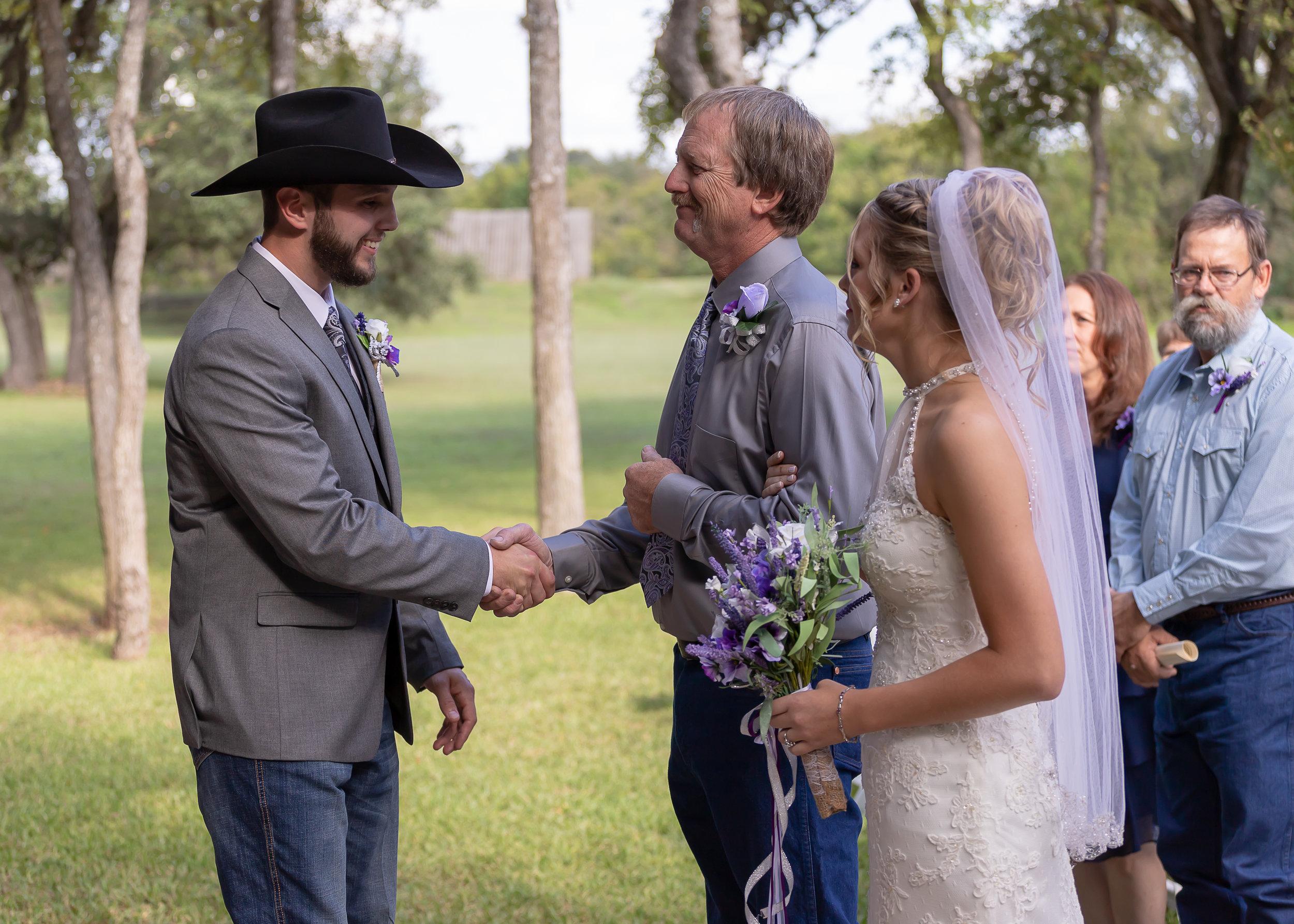 Hale Wedding shaking hands