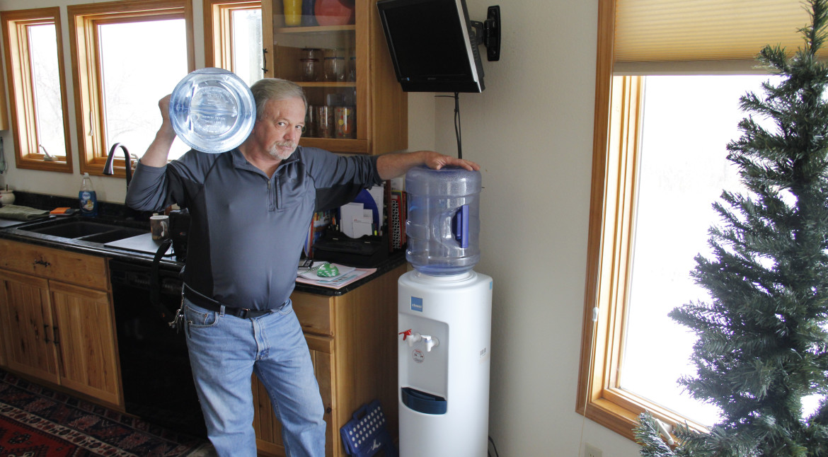 Frank Michna buys bottled water for drinking and cooking in his Caledonia home because of high levels of molybdenum and boron in his well.