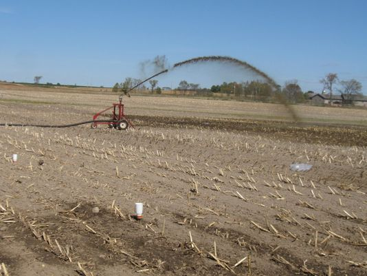 Manure is being applied via an irrigation system using a traveling gun and reel.(Photo: Courtesy Wisconsin Manure Irrigation Work, Wisconsin State Farmer Wisconsin Manure Irrigation Work)