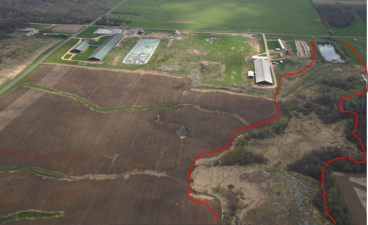 Aerial view of manure spill (inside red lines)
