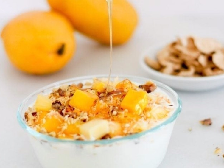Mango-Pineapple Yogurt Bowl   Ingredients  1 tablespoon unsweetened coconut flakes  1 cup (245 grams) plain low-fat yogurt  ¼ cup (45 grams) diced pineapple, fresh or frozen  ¼ cup (40 grams) diced mango, fresh or frozen  2 tablespoons toasted walnut pieces  Calories: 334 Fat: 16g Carbohydrate: 38g Protein: 16g
