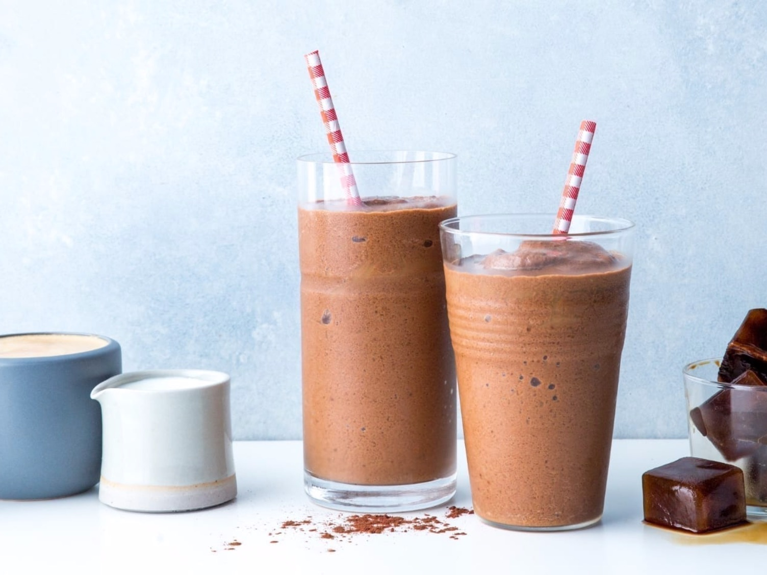 Cold Brew Mocha Smoothie   Ingredients  310ml cold brew coffee, frozen into cubes  1/2 cup 0% plain Greek yogurt  1/2 cup 2% milk or unsweetened almond milk  2 medjool dates, pitted  1 1/2 tablespoons unsweetened cocoa powder  1/2 teaspoon vanilla extract  Add in a scoop of whey/vegan protein powder for an extra 20-25g of protein  Calories: 154 Fat: 3g Carbohydrate: 26g Protein: 9g (Add whey/vegan powder = 29-35g protein)