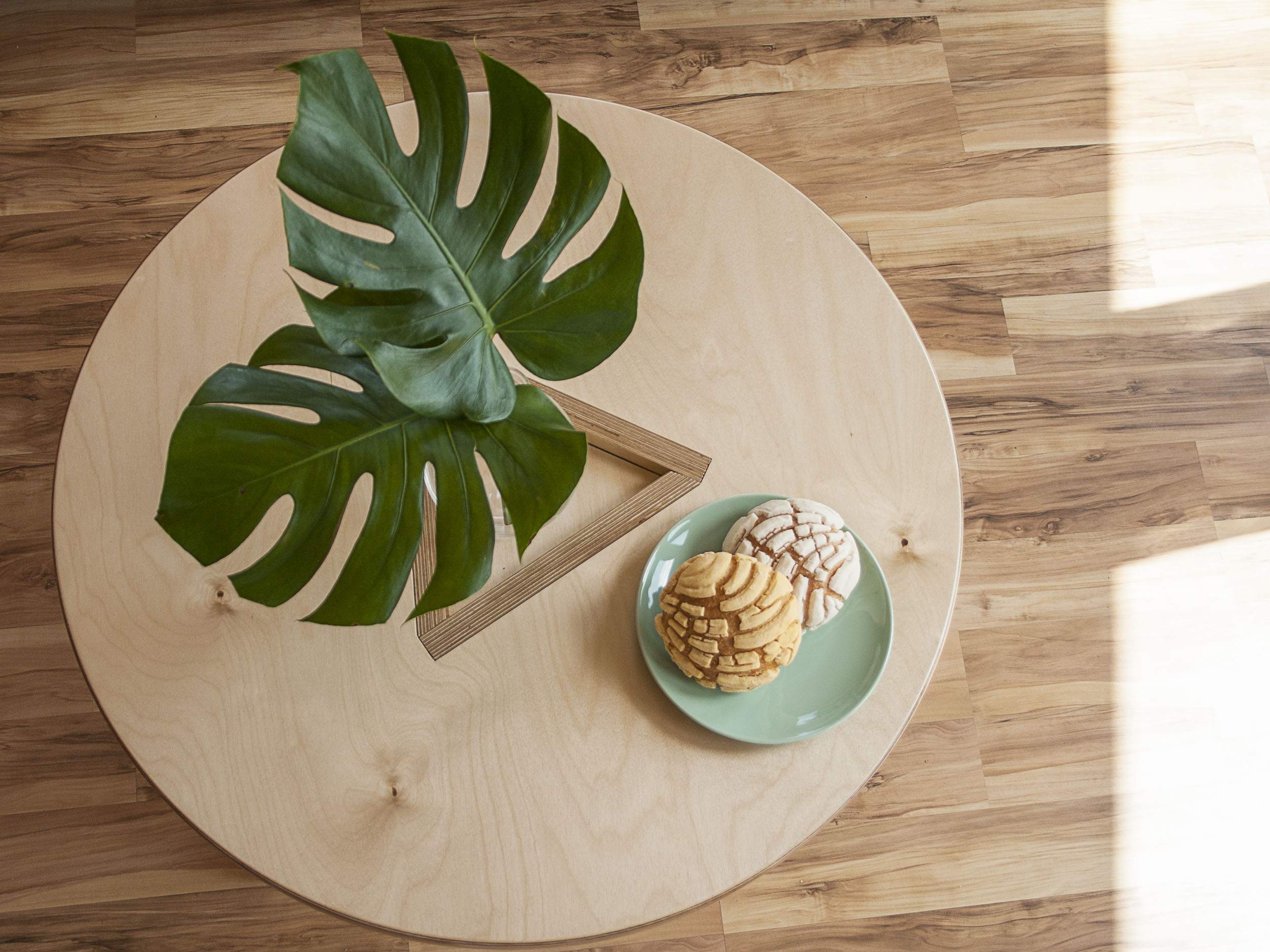 Everything in it's right place. - The BOHDII Coffee Table's clever construction creates a shallow, central,space that can be used to create arrangements of your favorite things.