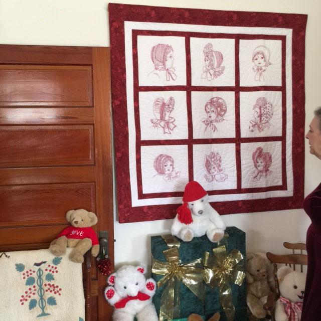 Christine admiring Jan Finkelstein  quilt in Childrens room.jpg