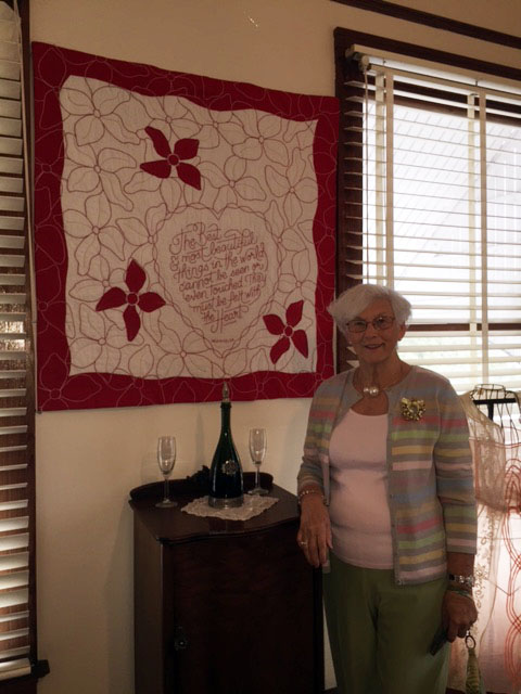Jane Hill and her beautiful  quilt.jpg