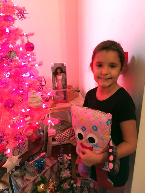 Natalie's grandaughter loving her  pillow pal and the pink tree in the children's room.jpg