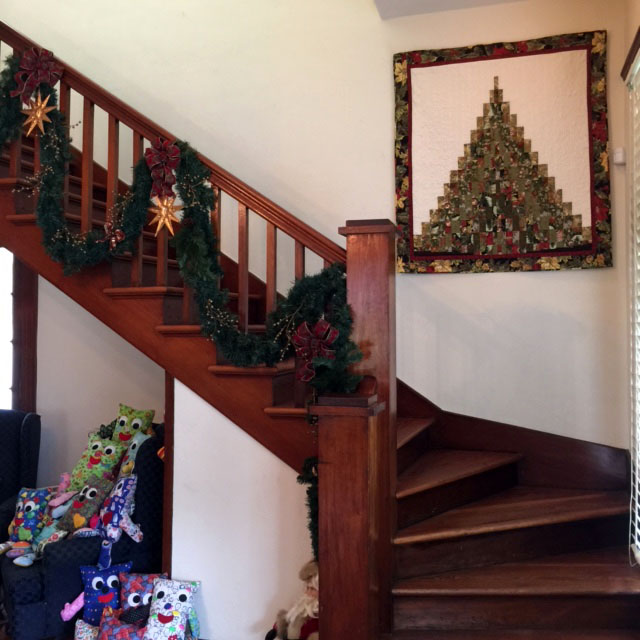 Stairs with Kathy Cochrane tree  quilt.jpg