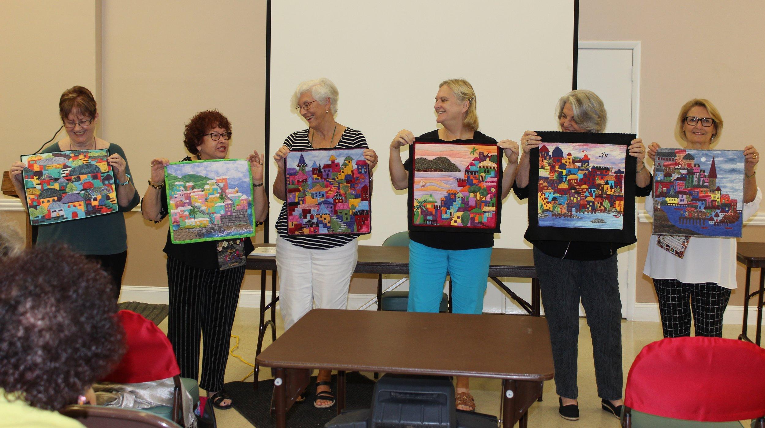 Karen Eckmeier Group of finished Happy Villages.jpg