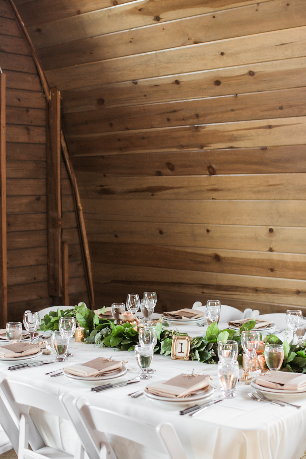 Greenery+Garland+centrepieces+-+Weddings+in+Winnipeg.jpeg