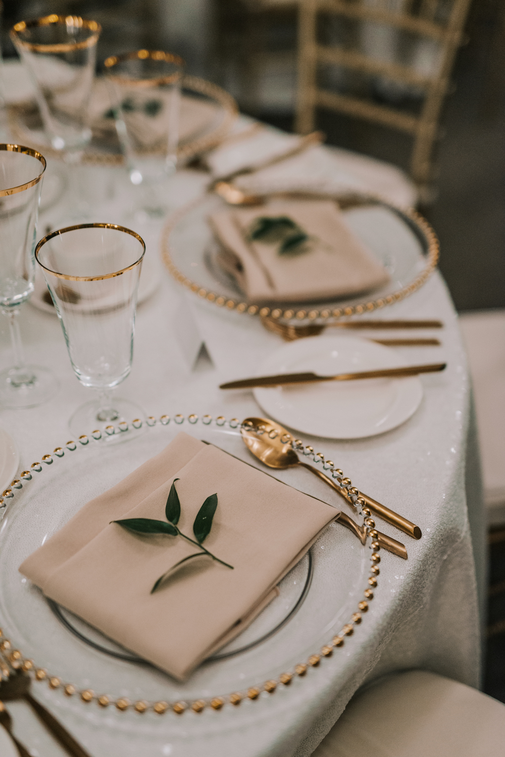 Greenery Sprig on Place Settings - Wedding Flower Ideas