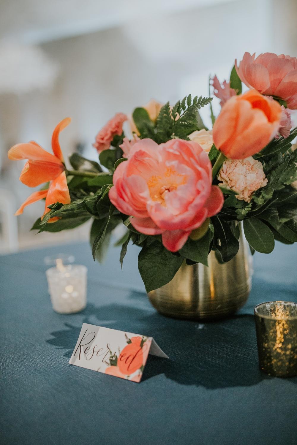 Orange and Coral Wedding Centrepiece - Vibrant Wedding Flower Ideas