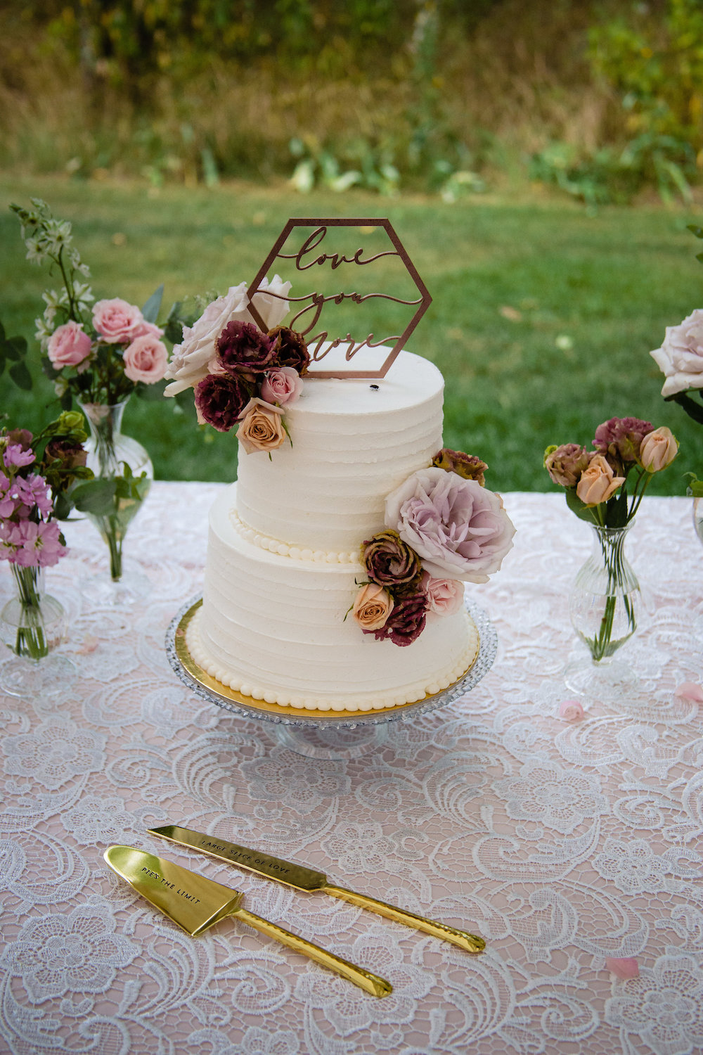 Buttercream Wedding Cake with Fresh Flowers - Wedding Planning in Winnipeg