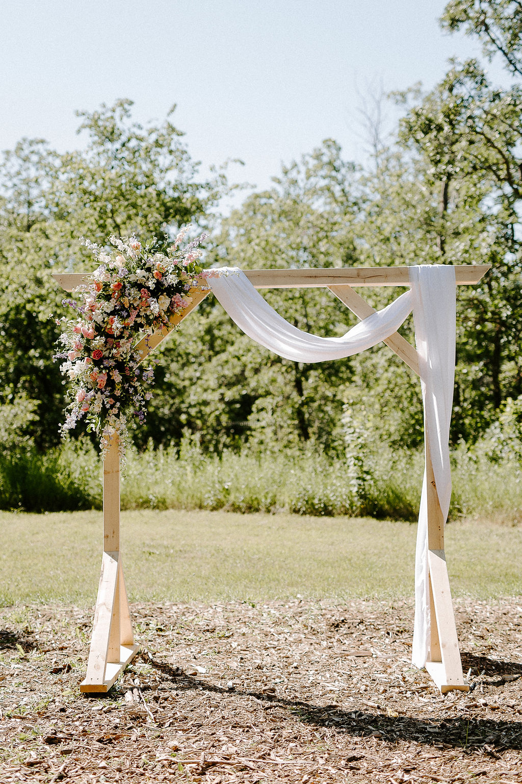 Wedding Arch with Blush and Lavender Flowers - Winnipeg's Top Wedding Florist