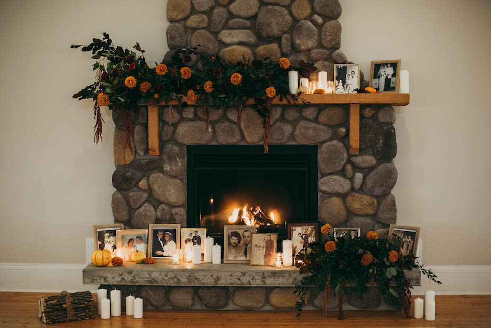 Fall Wedding in front of a Fireplace - Fireplace Mantle Floral Design