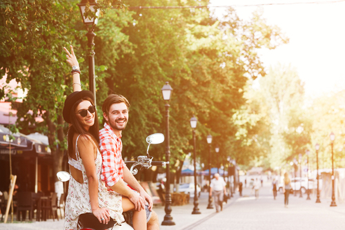 stock-photo-glamorous-happy-young-couple-riding-a-vintage-scooter-in-the-street-woman-wears-a-hat-and-380146306.jpg