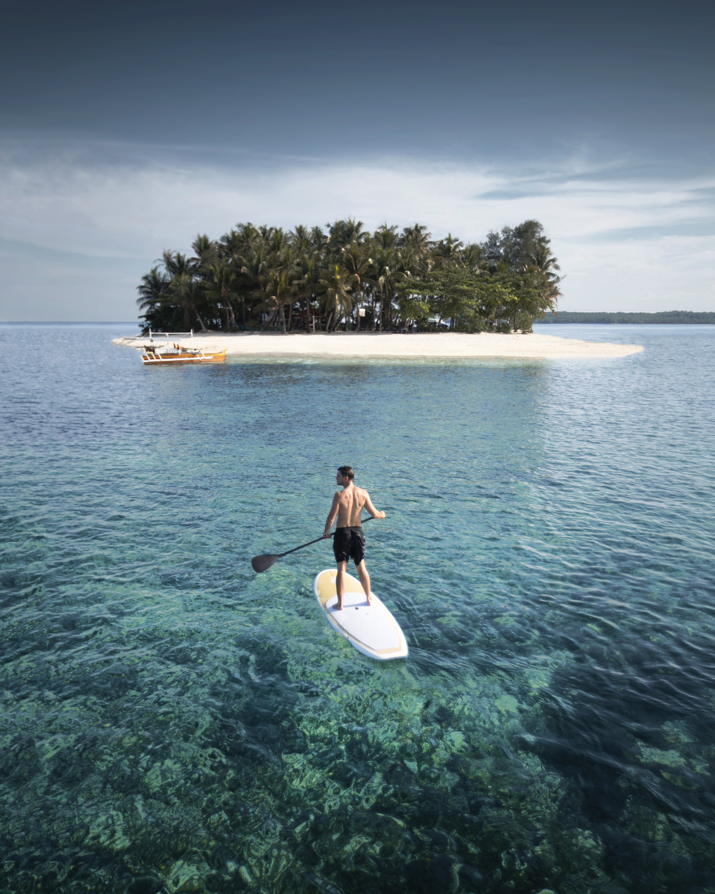 Lost LeBlanc on a paddle board in Siargo, Philippines.
