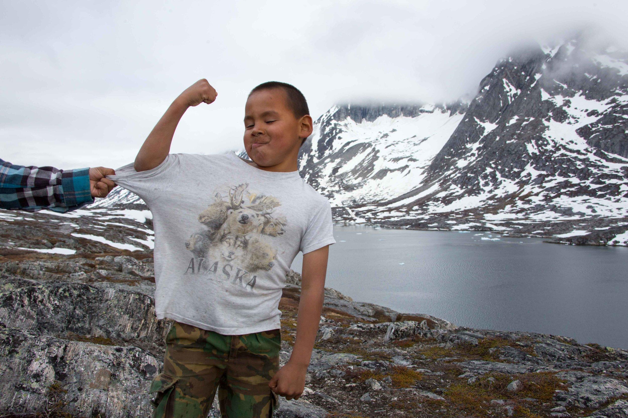 Local kids having a good time. Kuummiut, Greenland.
