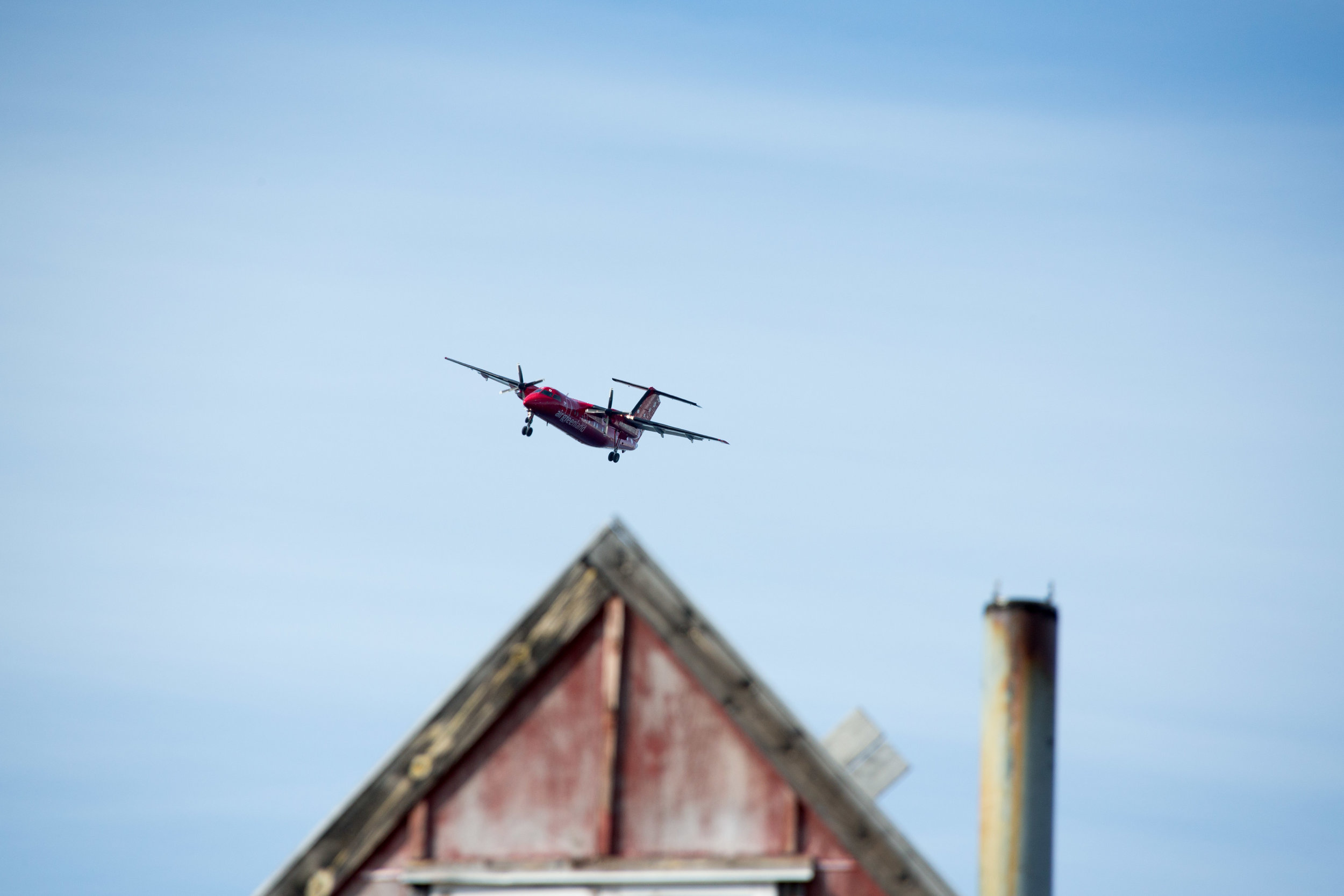 An Air Greenland flight approaches Kulusuk airport from Nuuk, Greenland.