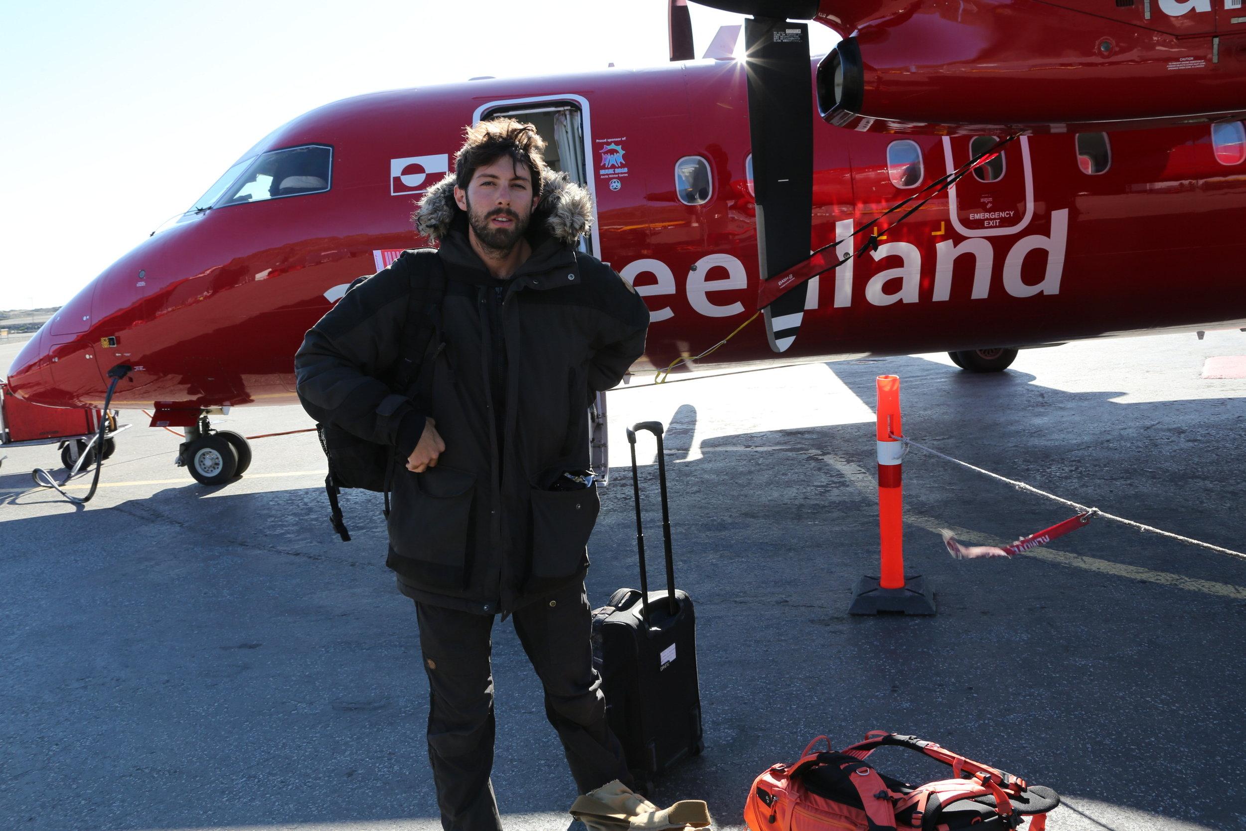 Karim standing besides the Air Greenland Dash-8 plane.
