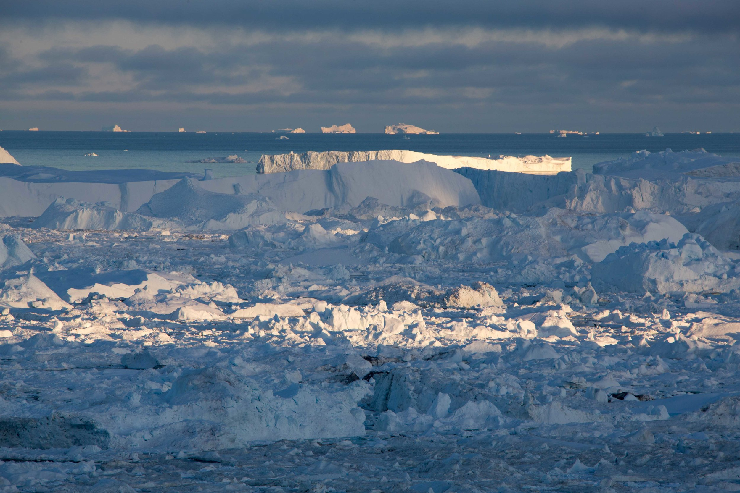 Sold yet? Icebergs from a massive glacier flow into the sea in Ilulissat, Greenland.