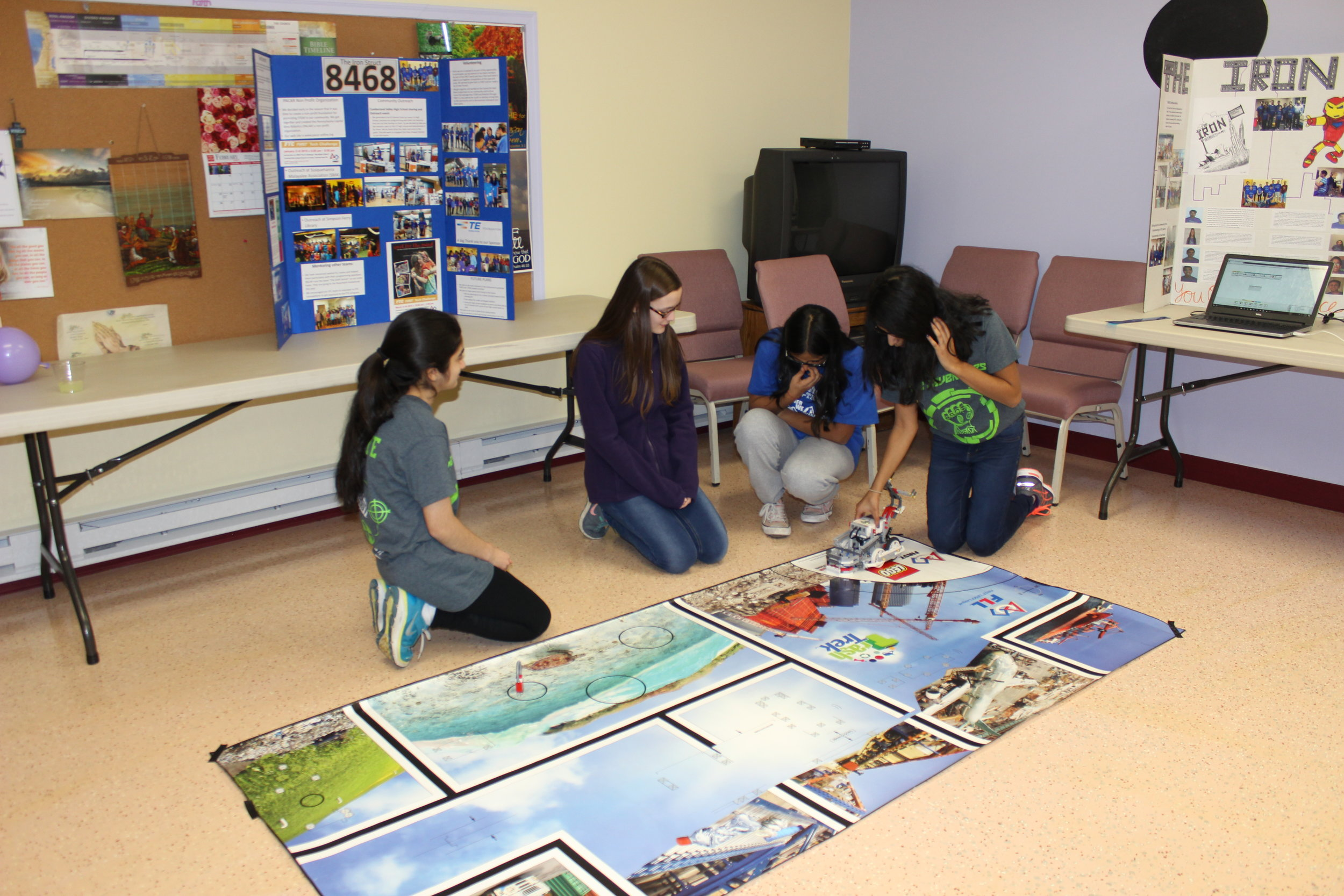 Krittika and Susan help the girls run their program on the Lego robot. Girl Scout Lock-in Outreach, February 2017.