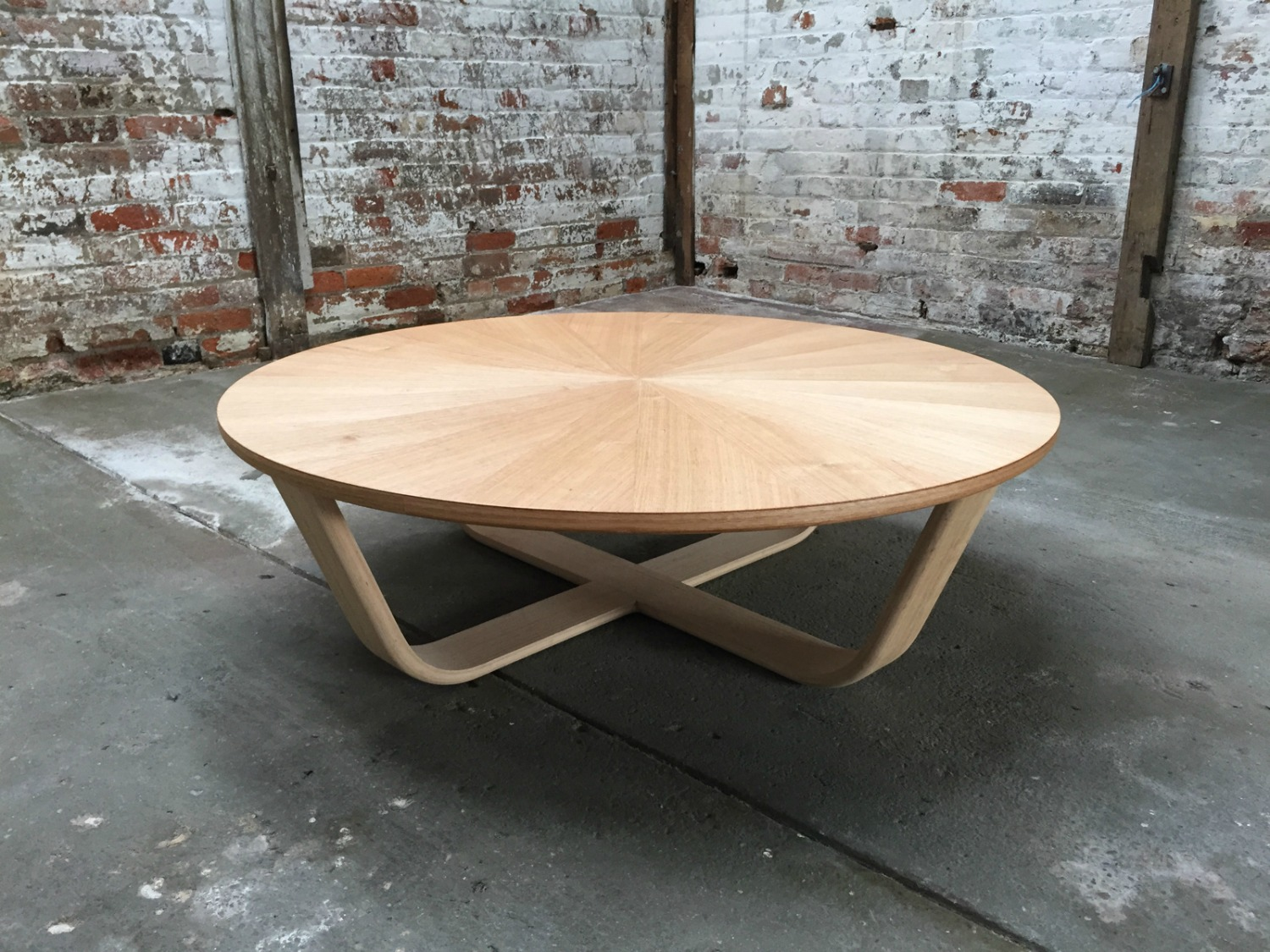 This striking handcrafted coffee table was designed by  Simon Ancher Studio , in Launceston TAS. A sunburst pattern is created by arranging veneer sheets around a centre point. The tapered shape of each segment draws the eye to the centre of the table.