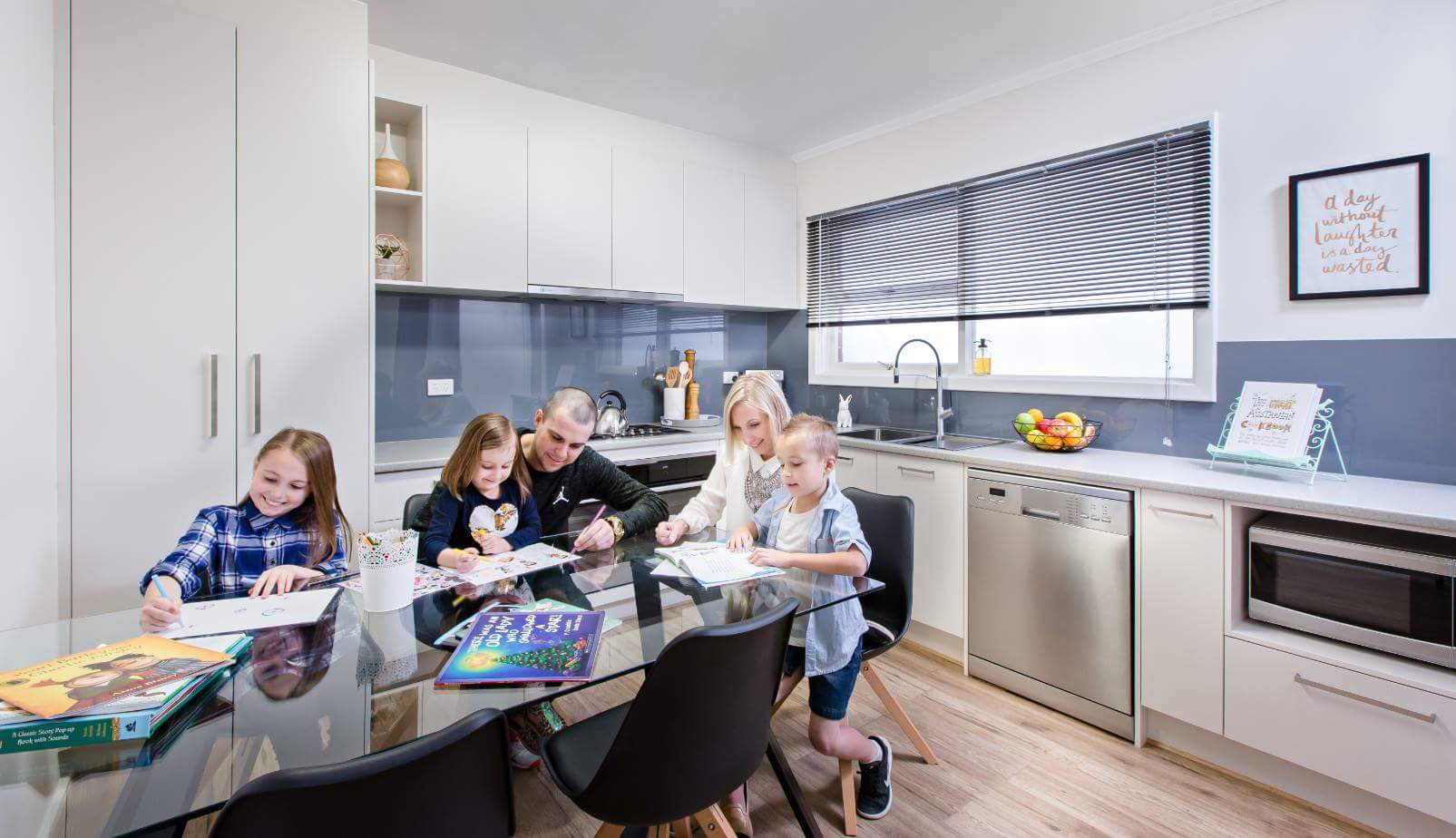 Emma and her family, enjoying the new kitchen |  source