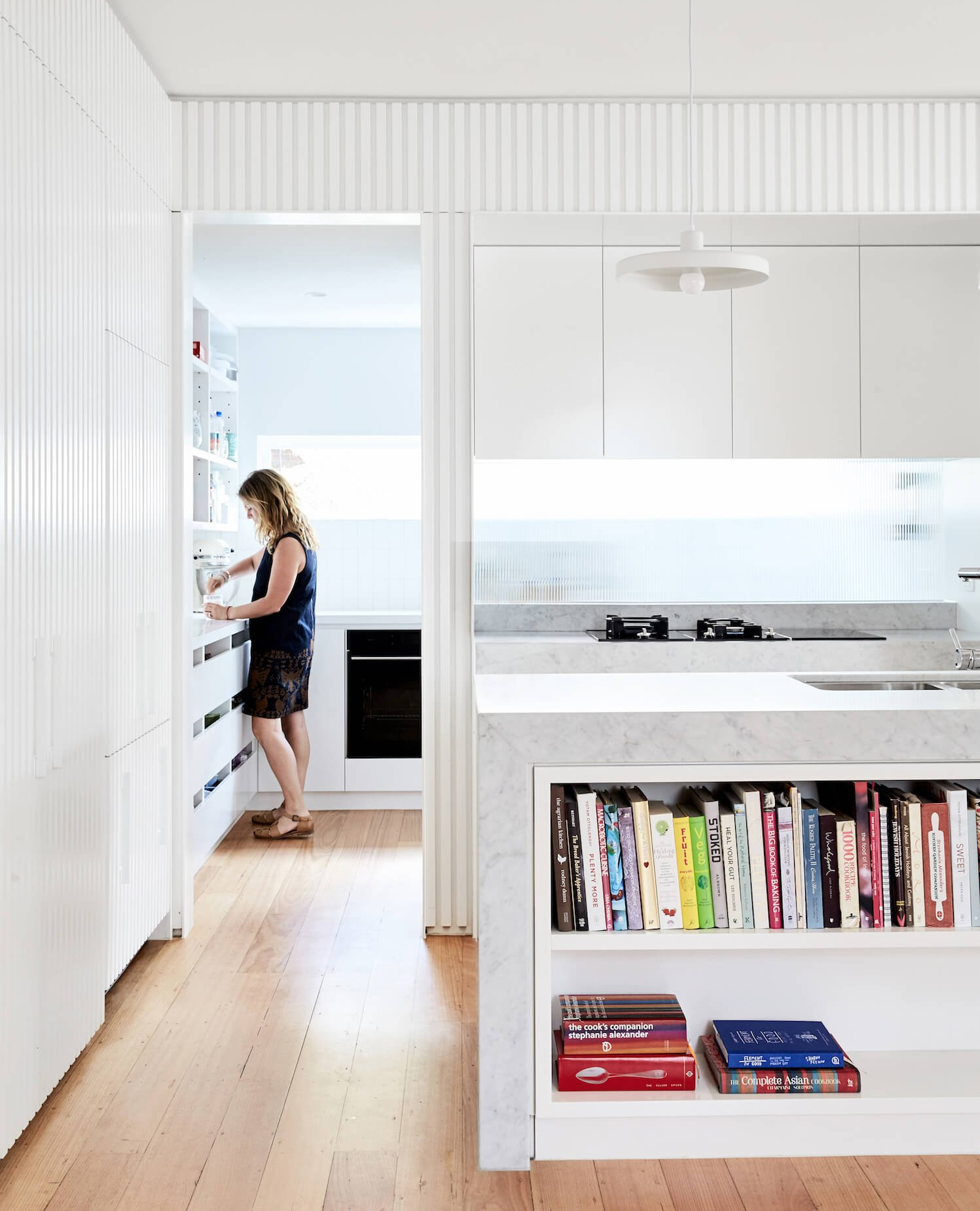 This second kitchen / walk in pantry by  Foomann Architects  has fantastic light. It's a place anyone would enjoy being in. Even if you're doing hum drum domestic tasks.