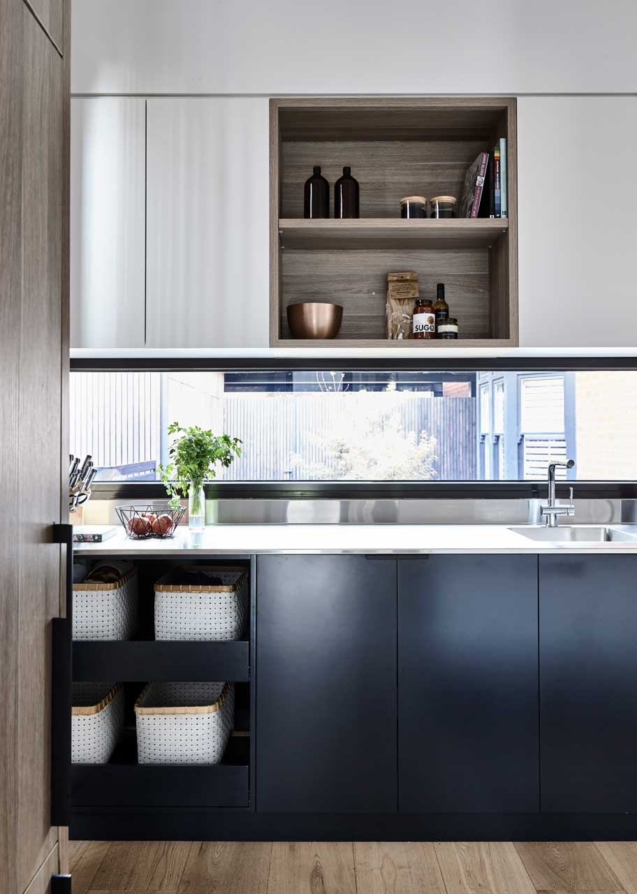 Window Splashback: An example, from  Austin Design , of how you can let lots of natural light into your pantry. Now you can see what you're doing without turning the lights on all the time.
