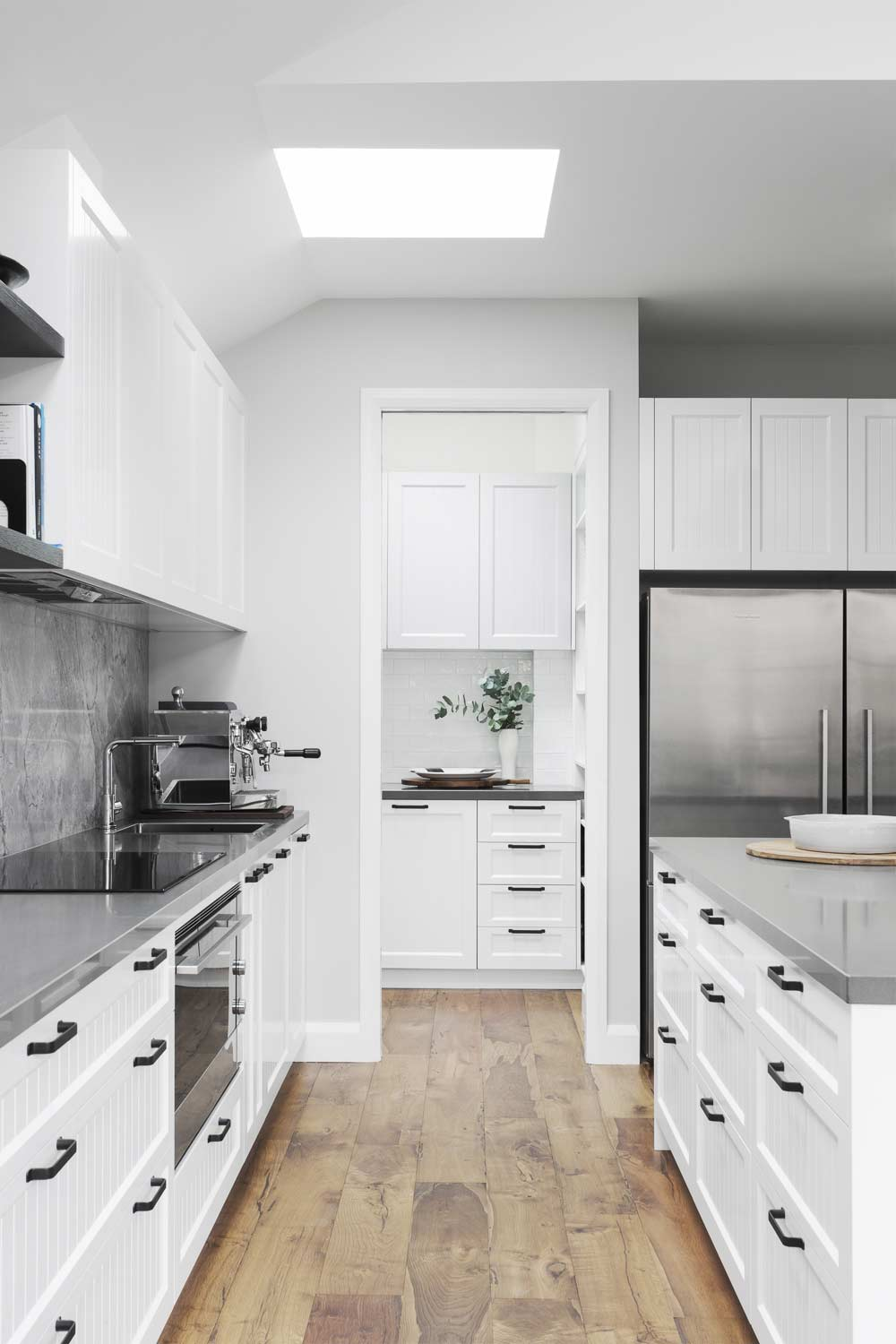 The butlers pantry is an extension of the kitchen. It can be another prep area that's also closed off to guests. A cavity slider door to the pantry is a great option. | kitchen by  GIA Renovations